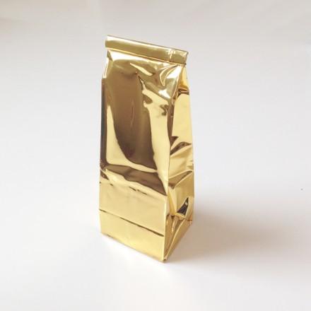 gouden blokvoetzakje + label